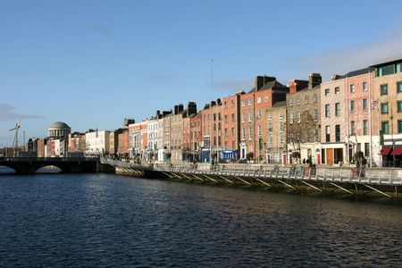 River Liffey and colorful buildings of Dublin city. Ireland landmark. Four Courts building in background. photo