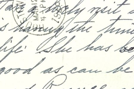 Vintage hand writing on a letter. Old yellowish paper with visible structure. Pen ink. Houston postmark from 1949. photo