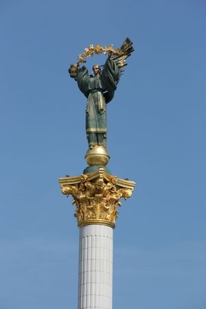 Famous statue on a column in Kiev, Ukraine. Bereginia (or Berehynia) stands on Maidan Nezalezhnosti (Independence Square) as a symbol of Ukrainian freedom. By Kiev people it is informally referred to as baba. photo