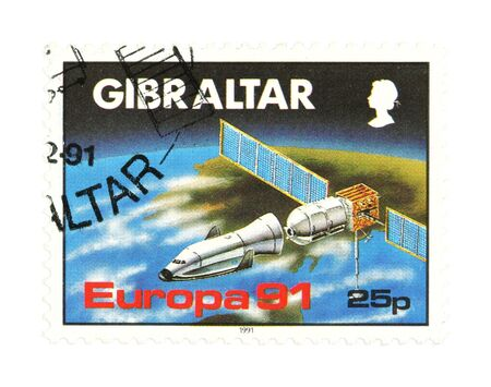 collectible: Collectible stamp from Gibraltar. One with a space station. Stock Photo