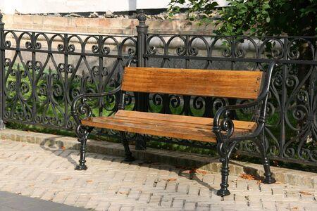 Single bench in a park in Pecherska Lavra, Kiev, Ukraine Фото со стока
