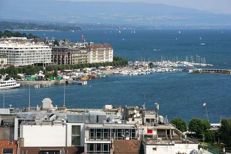 Famous city of business - Geneva, Switzerland. Lake Geneva (Lac Leman) and sailboats. Stock Photo - 3549528