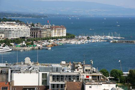leman: Famous city of business - Geneva, Switzerland. Lake Geneva (Lac Leman) and sailboats.
