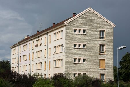 bourgogne: Average apartment block in Auxerre, department of Yonne, Burgundy, France. Stormy weather. Stock Photo