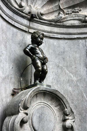peeing: Manneken Pis, also known in French as the petit Julien. Famous statue of peeing boy in Brussels, Belgium.