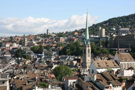 Cityscape of Zurich, Switzerland taken from Grossmuenster church. The distinctive tower is Predigerkirche (Preachers Church). photo