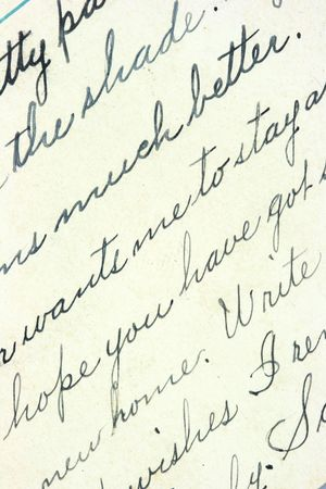 Vintage hand writing on a letter. Old paper with visible structure. Pen ink. photo