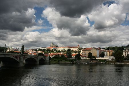 Beautiful cityscape of Prague, Czech Republic across the Vltava river. Mala Strana and Hradcany visible on the other side. Stormy weather. photo