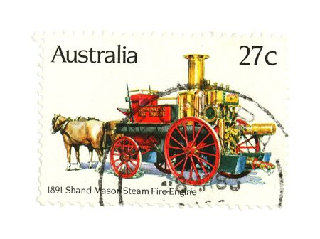 collectible: Collectible stamp from Australia. One with horse drawn steam fire engine. Stock Photo