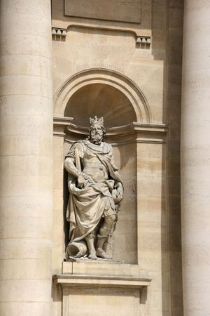 invalides: Sculpture depicting famous French king: Charles the Great (Charlemagne). Monument by Charles Antoine Coysevox. Hotel Des Invalides facade, Paris, France. Stock Photo