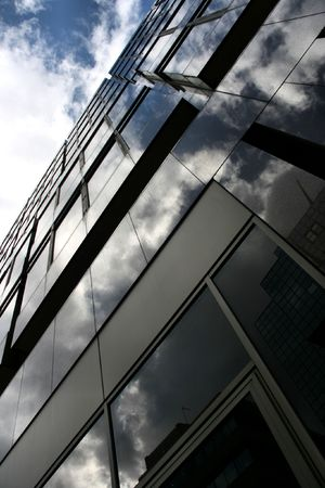 highriser: Blue sky, white clouds and modern office building in London, England Stock Photo