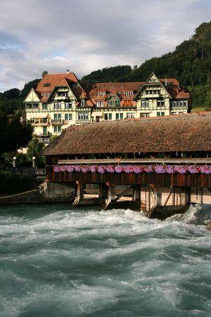sluice: Famous old, wooden sluice bridge in Thun, Switzerland. Aare river.