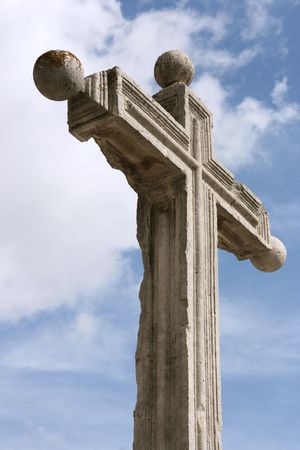 Holy symbol of Christinity - a stone Cross in front of Valladolid cathedral in Spain photo