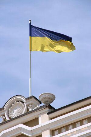 National flag of Ukraine on a windy day. Kiev detail.
