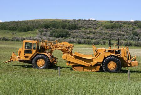 Heavy duty scraper - earth moving machine in Canada. Wheel tractor-scraper. Stock Photo