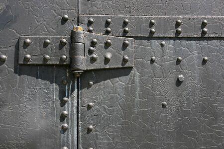 hinge: Industrial steel tin door texture. Metal hinge and bolts. Stock Photo