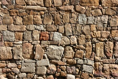 fortified wall: Stone wall background texture. City walls in Avila, Spain. Stock Photo
