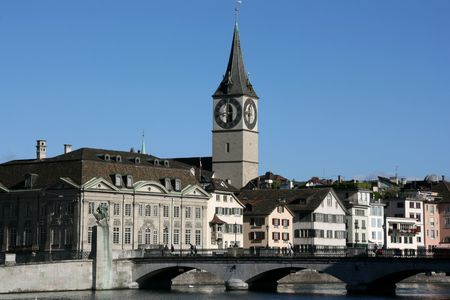 peters: Zurich cityscape. St. Peters Church tower with worlds largest church clock face. Swiss city. Limmat river connecting with Lake Zurich. Stock Photo