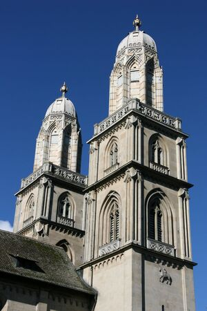 Beautiful towers of Romanesque style ex-cathedral church in Zurich, Switzerland. The church had important role in both Protestant and Catholic denominations. photo