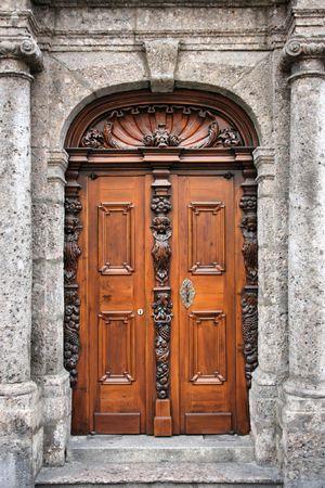 Beautiful, decorative wooden door in Innsbruck, Tirol, Austria. Stock Photo - 3851216