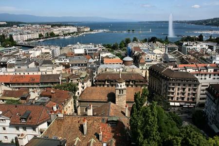 Famous city of business - Geneva, Switzerland. Lake Geneva (Lac Leman), fountain and sailboats. Stock Photo