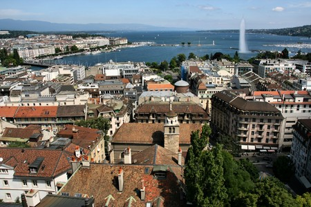 Famous city of business - Geneva, Switzerland. Lake Geneva (Lac Leman), fountain and sailboats. Stock Photo