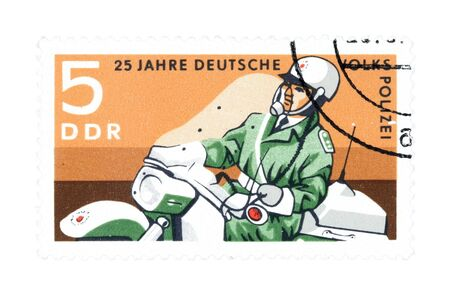 collectible: Collectible stamp from East Germany. Stamp with police officer on motorcycle.