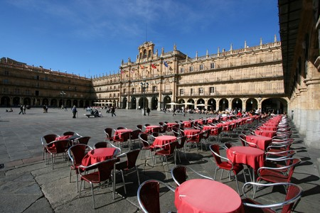 Plaza Mayor - main city square in Salamanca, Castilla y Leon, Spain. Many tourists and local people walking and sitting around.