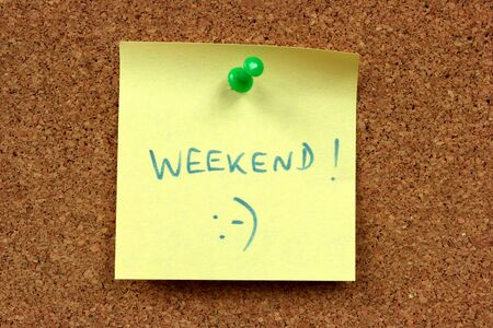 Yellow small sticky note on an office cork bulletin board. Weekend happiness. Stock Photo - 4014171