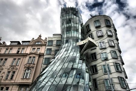 town houses capital: Famous landmark of Prague - Dancing House. HDR photo.