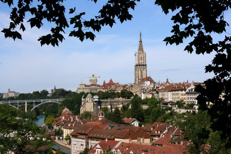 prominent: Bern, Switzerland. Beautiful old town. Prominent cathedral tower. Kirchenfeld Bridge on the left. Stock Photo