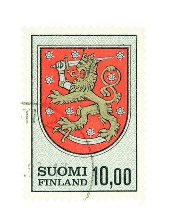collectible: Collectible old stamp from Finland. Stamp with Finnish national emblem. Stock Photo