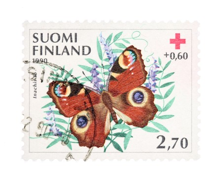 collectible: Collectible old stamp from Finland. Stamp with European Peacock butterfly (Inachis io). Stock Photo