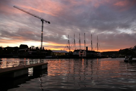 Bristol Harbour in beautiful sunset light. Famous SS Great Britain sailing ship visible in the dock.