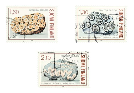 felsic: Collectible old stamps from Finland. Set with granite rocks. Geology. Stock Photo