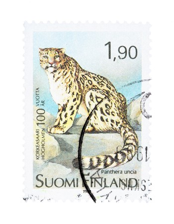 collectible: Collectible old stamp from Finland. Stamp with snow leopard (panthera uncia) Stock Photo