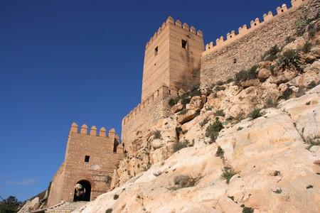 alcazaba: Alcazaba - fortified Moorish castle on a rocky hill in Almeria, Andalusia, Spain. Stock Photo