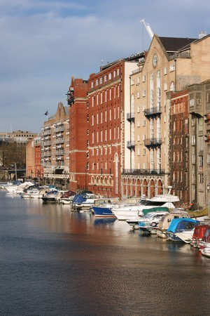 Bristol - boats and buildings seen from Redcliffe Bridge. United Kingdom. photo