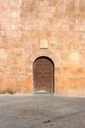 santo domingo: Murcia - Santo Domingo (Saint Dominic) church. Small door to a huge building.