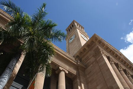 Brisbane city hall and a palm tree. Summer day. Stock Photo