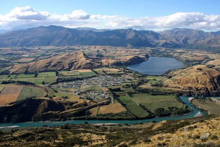 australasia: Lake Hayes as seen from the Remarkables in Otago region, New Zealand. Crown Range mountains behind the lake.