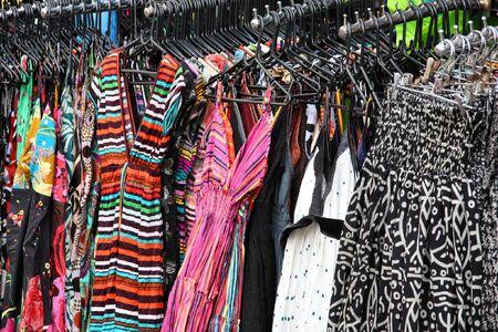 khao: Colorful dresses at a market stall. Famous Khao San street in Bangkok, Thailand. Stock Photo