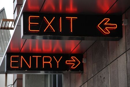 Exit and entry neon signs in Christchurch, New Zealand photo