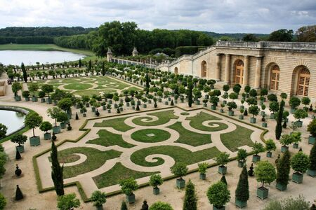 versailles: Versailles - beautiful ornamental gardens and French chateau. National landmark of France.