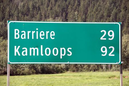 distances: Distances on a road sign in British Columbia: Barriere and Kamloops Stock Photo