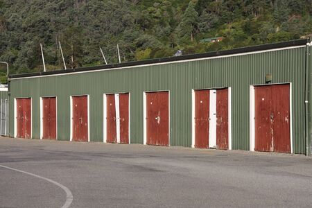 Row of industrial garage gates or warehouse doors in Picton, New Zealand. Steel structure. Stock Photo - 4868503