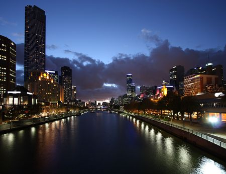 Melbourne night view. Beautiful city of skyscrapers. Yarra River. The prominent building is Eureka Tower, which is the worlds tallest residential tower when measured to its highest floor. Stock Photo