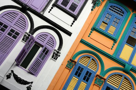 Closed colorful window shutters in Chinatown district of Singapore, Asia photo