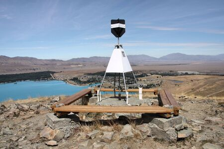 geodetic: Geodetic survey marker at Mt. John, Canterbury, New Zealand. Lake Tekapo visible on the left.