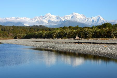 Incredible view of snowy peaks. Mountain landscape including Aoraki Mt. Cook and Mt. Tasman of Southern Alps. New Zealand vista seen from Gillespies Beach. photo